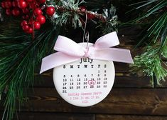 This adorable ceramic ornament is personalized with the Babys Birthday! The day is circled with a precious red, blue or pink heart. All of Babys information is printed in typewriter font. To finish, the ornament is topped with coordinating red, blue or pink grosgrain ribbon. This is the