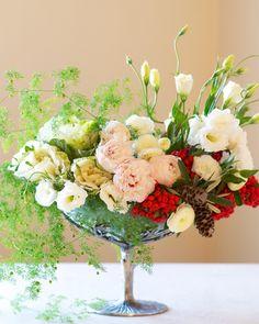 Ranunculus, peony, ornamental kale, lisianthus, fern, red winter berries  cones. #christmas #flowers #centerpice