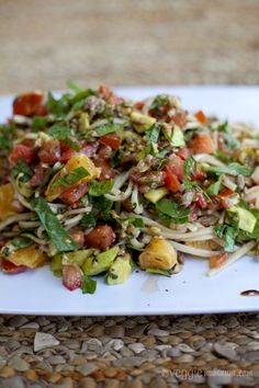 Udon noodles, sunflower seeds, fresh basil & mint leaves, sun ripened tomatoes, avocado, oranges,   1 cup spinach leaves, shredded  #vegetarian #recipe  ¼ small red onion, finely diced