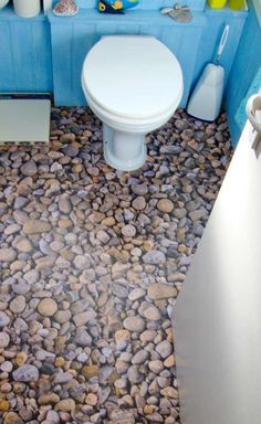 Bathroom with our amazing River Rock floor design. Only at Harvey Maria.