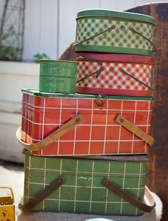 Vintage green and red picnic basket tins.  Via A Sort Of Fairytale