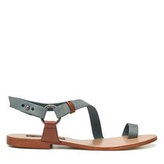 Dreamwalker Sandal is a two tone wrap around sandal with toe piece. The strap is looped through a gunmetal ring and fastened with a mushroom stud. The main colour is a beautiful soft denim leather with dark tan highlight trims. The insole is all leather and the outsole is resin for longer wear. The sandal is completely leather lined.