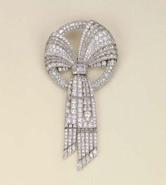 AN ART DECO PLATINUM AND DIAMOND BOW BROOCH, BY HARVEY & GORE LONDON