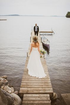 Photography: Mango Studios - mangostudios.com Wedding Dress: Ivy And Aster - ivyandaster.com Read More on SMP: http://www.stylemepretty.com/canada-weddings/2014/05/16/cottage-wedding-lakesimcoe/