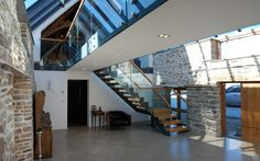 Medieval Tithe Grade II* Listed Barn Conversion by The Bazeley Partnership Architects in Cornwall Agricultural Buildings, Contemporary Barn, Architectural Services, Corner House, Listed Building, Planning Permission, Glass Roof, Home Projects, Bude Cornwall