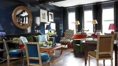 Study with dark blue laquered walls (Farrow & Ball's Hague Blue). Designer: Miles Redd