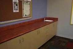 Custom laminate countertop with Karran Seamless Undermount sink on laminate cabinetry. Brea, CA.