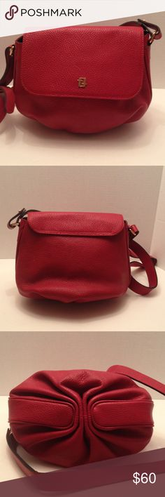 "Red leather cross body purse Cuero Vaca Beautiful red leather handbag with adjustable strap, snap closure, clean leather lining with zip closure pocket. 2 gold tone ff on front of bag. Purse made in Industria Argentina # E 232104/3. 9"" tall, 11"" across, 19"" strap Cuero Vaca Bags Crossbody Bags"