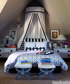 A dreamy canopy gets a modern update in black and white. In the guest bedroom of a California cottage, designer Stephen Shubel crowned the king-size bed with a dramatic canopy and used contrasting black-and-white fabrics to add graphic impact. Click through for more stunning canopy ideas.