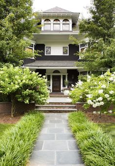 Norris took design cues from the home's historic roots. The exterior was updated with a moody midnight-blue hue.   An 1898 Home That Mixes Worldly Design with Historical Charm Photos   Designer Jenny J Norris   Architectural Digest