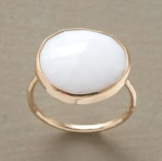 When I was really little I had an opal ring, my birthstone, and I would love to get one similar to this today.