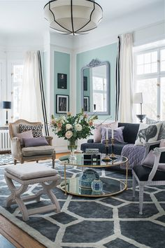 Dusty greens, purples, pinks and greys - a soothing colour combination well suited for a Iivingroom. Interior design: www.tretowdeco.com. Photo:Anne Nyblaeus