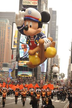 "The ad read, ""See gigantic balloons designed by none other than Walt Disney, creator of Mickey Mouse himself!"" It was New York City and Mickey Mouse was about to make his grand debut in the Macy's Santa Claus Parade (now Macy's Thanksgiving In Nyc, Macys Thanksgiving Parade, Thanksgiving History, Fosse Commune, American Festivals, Mickey Mouse, Disney Balloons, Giant Balloons, Counting Worksheet"