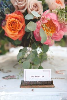 place cards held by a floral frog // photo by Bit of Ivory Photography // flowers and styling by Isha Foss Events // view more: http://ruffledblog.com/frank-lloyd-wright-wedding-inspiration/