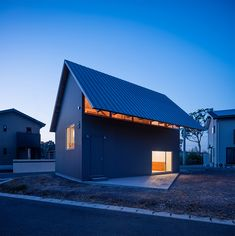 house in bungotakada by YAA is topped with a giant gable roof