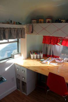 Craft Trailer, My 1960 Streamline travel trailer turned stationary CRAFT TRAILER STUDIO!, Craft table - milk glass tumblers and brass holder...