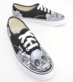These custom hand-painted, one-of-a-kind Black Vans Authentic Lace Up Sneakers feature a black and white skull and rose theme. This image is made-to-order and available on any style Vans. (Authentic,