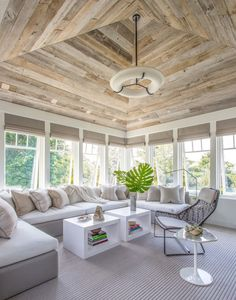 Ceiling made of reclaimed woods. This tone could be used on living room side of kitchen peninsula. Base boards simple craftsman painted to match wall color. I like the height of the base boards too. Neutral color palette was used throughout the home. Cape Cod - Coastal Style - Vacation Home