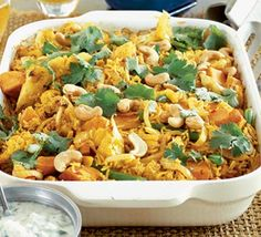 Spicy Vegetable Biryani. Made with cauliflower, sweet potato and green beans. Serve with poppadums and raita.