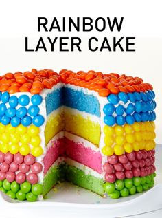 This Rainbow Layer Cake is four sweet layers of brightly colored cake coated creamy vanilla icing and decorated with Skittles . While this cake is jaw-droppingly impressive, it's also surprisingly simple to make. #BiteMeMore #rainbow #skittles #recipes