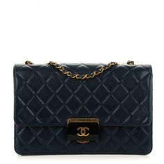This is an authentic CHANEL Sheepskin Quilted Large Beauty Lock Flap in Navy. This classic flap bagis crafted of diamond-quilted sheepskin leather in a deep blue.