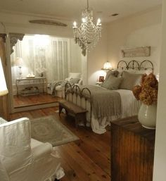 A  spacious Bedroom with interesting interior design features such as the huge Bay Window,Chandelier and beautiful woodwork designs.