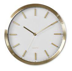 Modern klocka i mässing med svart eller vit urtavla.