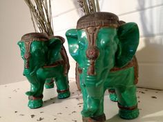 Pair of painted ceramic green and gold Indian elephants planter pot decoration. $18.00, via Etsy.