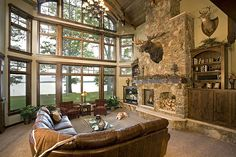 Lake and Home Magazine - This Feature Home's great room features incredible windows with a view to the lake and a massive stone fireplace