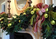 Gorgeous holiday garland. Mantel decor. Fruits and ribbons.