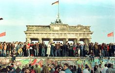 Nov. 10th 1989: West Berliners continue their vigil atop the Berlin Wall in front of the Brandenburg Gate.