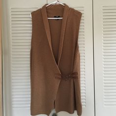 H&M Sweater Vest Never been Worn! No snags! Pretty tan sweater vest with two adjustable buckles in acrylic. H&M Sweaters Cardigans