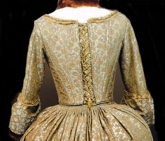 Claire's Green Brocade gown, worn to the banquet for the Duke of Sandringham at Castle Leoch   Outlander S1bE10 'By the Pricking of My Thumbs' on Starz   Costume Designer TERRY DRESBACH www.terrydresbach.com