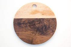 """Simple cutting board handcrafted from local hardwoods. Finished with a food safe butcher block oil. 3/4"""" thick. Birdseye Maple and Walnut"""