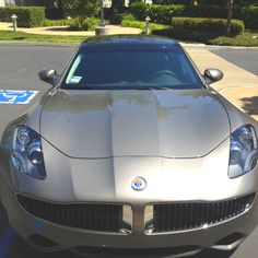 Sitting outside today on break and this pulls up, a Fisker Karma. Very cool car.