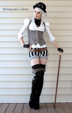 Grey under bust vest, puffy sleeves, belt accessories, hat, cane, gloves, goggles, etc. It's the details.