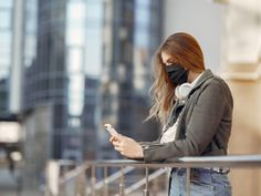 Woman in a mask stands on the street by prostooleh. Woman in the city. Person in a mask. Girl walks with phone and headphones. Nose Strips, Fashion Articles, Camo Print, Leather Jacket, Sport, Film, Cover, Cotton, Free Uk