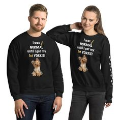 A new sweatshirt for Yorkshire Terrier mom and parent from our collection, Almost normal, with white print paws on the left sleeve.