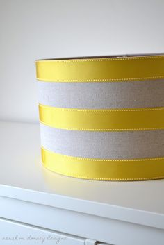 Smart, cheap, and easy.  She's going to put this lamp shade with ribbon over a boring ceiling light.