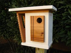 Modern style birdhome handcrafted in Tennessee. Made of southern yellow pine painted with exterior grade low VOC paint to protect from elements. The natural wood sections are made from cedar and are oiled to maintain the rich color. It is suggested to oil these parts twice per year to
