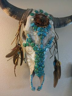 A Lace pattern buffalo skull made with turquoise and bb's brings femininity to the native american art.