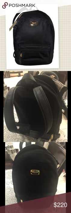 """MICHAEL KORS BACK PACK AUTHENTIC Michael Kors chic nylon back pack. Work wear inspired hard ware lends cosmopolitan edge to a classic, sporty look. Features dual leather adjustable straps, gold tone hardware. Has spacious interior pockets. Exterior zippered pocket. 11.5""""L x15""""H x 5""""W. PRICE IS FIRM Michael Kors Bags Backpacks"""