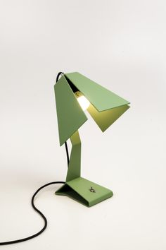 Lamp LUMI, shy looking desklamp, made from one piece of sheet metal. Brass green with dark grey textile power cord. design by heetmanpatijn.nl for DriVK.com