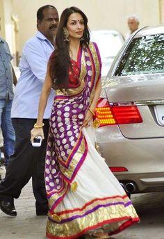Sept, 2013: Malaika in Laila Motwane https://www.facebook.com/LailaMotwaneDesign lehenga going for Ganpati Visarjan at Salman Khan's residence.