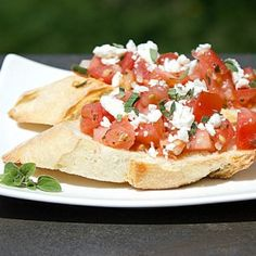 Classic Tomato and Feta Bruschetta- I eat this all summer long! I like to substitute chives instead of onion and no oregano.