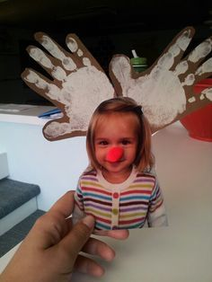 Reindeer craft. Use beige paint on brown paper to make handprints, cut out to make antlers, add red pom pom nose. You can make it into a magnet or an ornament. :)