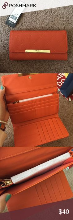 Orange BCBG Paris wallet It's an orange wallet I got my mother for christmas she didn't like it and it was too late to return. Has a lot of space BCBG Bags Wallets