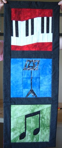 """Made for daughter's MS choir director (2007).  Paper pieced patterns from """"24 Musical Quilt Blocks"""" by Linda Causee."""