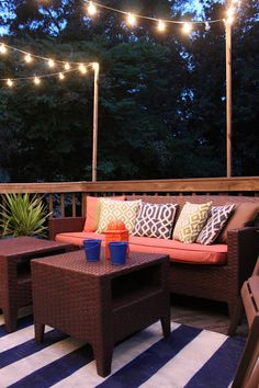 outdoor rug for the deck, with comfortable seating, plants, and lights strung for lights... doesn't have to be a lot. just simple touches