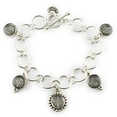 Virgins, Saints and Angels Piccolo Charm Bracelet - Silver. Open link charm bracelet featuring the powerful symbol of peace.  Handmade in USA.  $262
